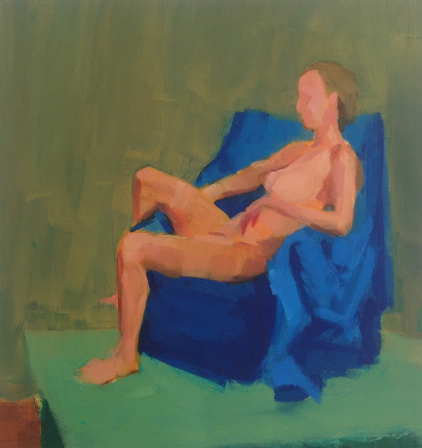 Woman on a blue chair on a green floor